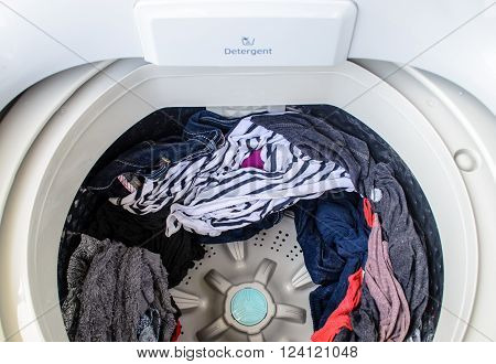 Clothes in machine ready for hanging out