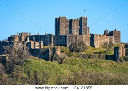 Dover United Kingdom - March 25 2016: View to Dover Castle with copy space in sky. Castle was founded in the 11th century for protect the town and surrounding area for hundreds of years. Also known as Key to England.