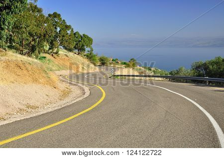 Curving highway leading down to Kinneret lake. Israel.