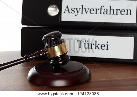 gavel on table and text: procedure for granting the right of asylum and Turkey