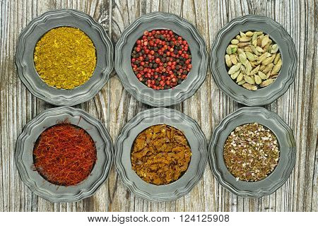 Spices and herbs in metal bowls. Food and cuisine ingredients. Colorful natural additives