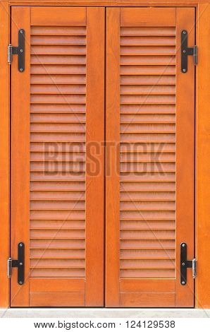Window of a house closed with wooden shutters.