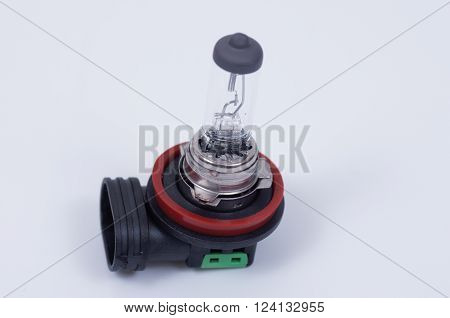 A halogen car headlamp bulb on a white background.