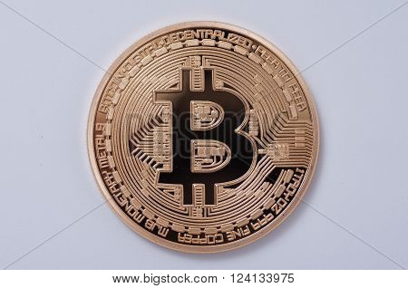 Saransk, Russia - April 2, 2016: Gold-plated Bitcoin on a white background.