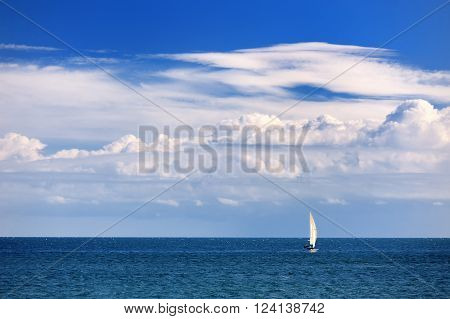 sea clouds sky and sail boat in Apulia Southern Italy