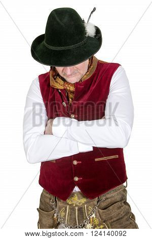 isolated portrait of bavarian man in traditional clothes looking down