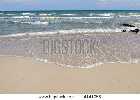 wave of the sea on the sand beach in summer - Apulia Southern Italy