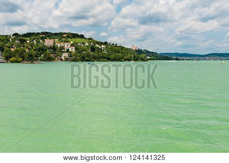landscape. azure water and blue cloudy sky