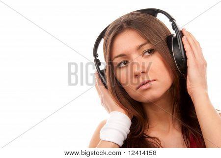 Brunette Young Woman Listening Music In Headphones