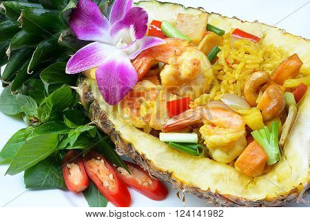 a pineapple rice with pineapple served in a pineapple plate oriental food Special