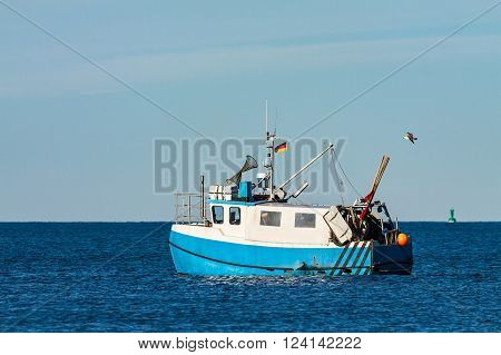 A fishing boat on the Baltic Sea in Warnemuende (Germany).