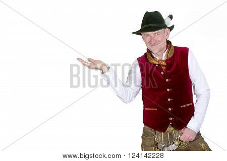 isolated portrait of bavarian man in traditional clothes holding up his hand