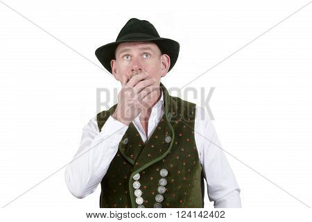 portrait of astonished bavarian man wearing traditional bavarian clothes looking up