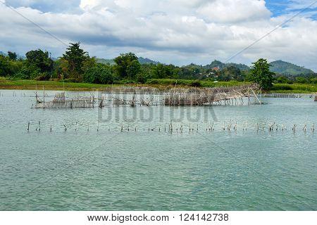 Fish Farm And Hatchery On Poso River Near Tentena. Indonesia