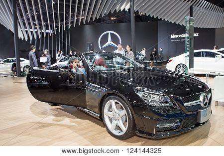 Bangkok - March 22 : black Benz series SLK 200 and unidentified customer - in display at The 37th Bangkok international Motor Show 2016 on March 22, 2016 in Bangkok Thailand