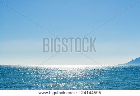 View of beautiful landscape: sea and sunny sky, Promenade de la Croisette, the Croisette and Port Le Vieux of Cannes, France Cote d'Azur