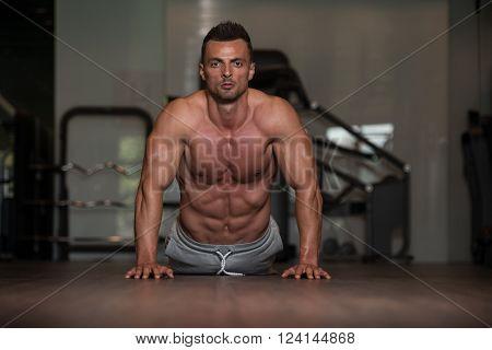Bodybuilder Doing Push Ups On Floor