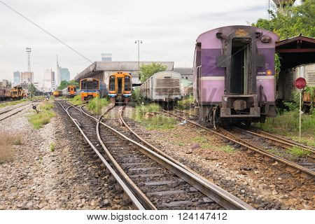 Bangkok Thailand - September 5 2015 : Unidentified railway train on the railroad tracks in Bangkok station. Many people in Thailand popular travel by train because it is cheaper.