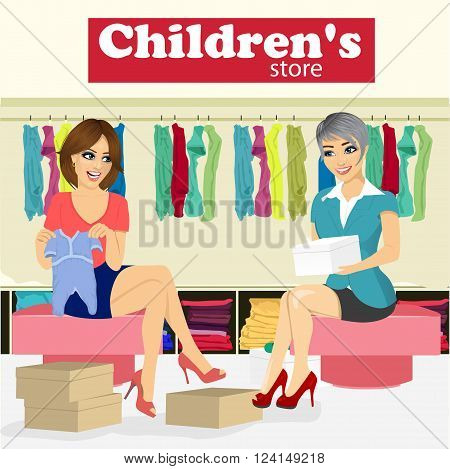 attractive woman chooses baby clothes for her pregnant girlfriend in the children's store with help of store assistant