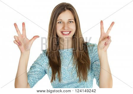 Young smiling woman showing victory or peace sign, isolated on white background