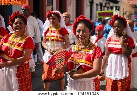 SAN CRISTOBAL DE LAS CASAS MEXICO 13 DECEMBER 2015: Women in traditional Chiapas dress walking outdoors