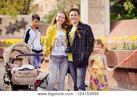 Volgograd, Russia - May 9, 2014: Ivanov's family with children walks down the avenue of heroes of Volgograd. This day is celebrated by the most revered holiday in Russia - Victory Day.