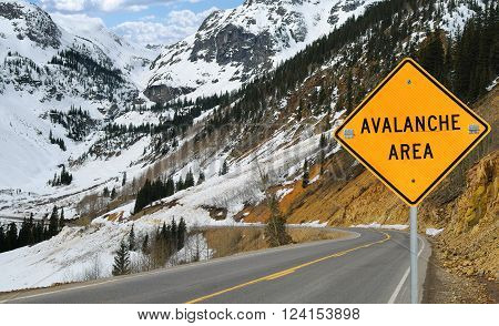Avalanche and Sign:  A sign warns motorists in an area of southwest Colorado where an avalanche has recently covered the road.