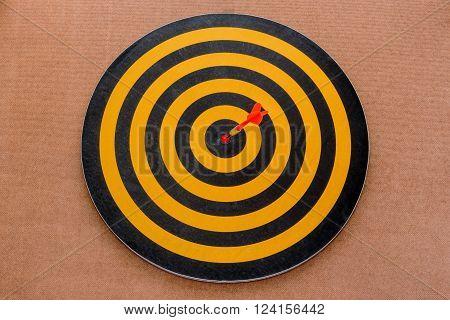 dart hitting in bullseye target on dartboard