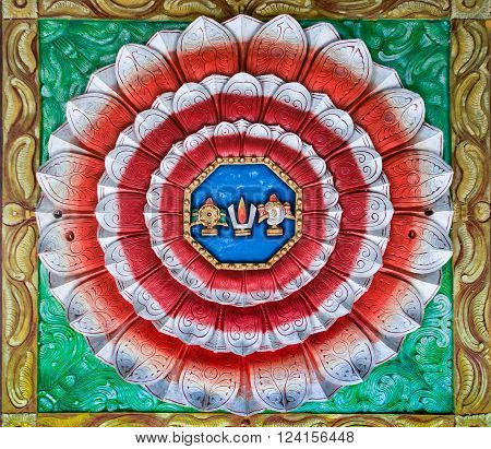 Trichy India - October 15 2013: Rosas Mandala lotus shaped painting on the ceiling of Anna Mandapam. The colors of the Indian flag with the symbols of Lord Vishnu in the center.