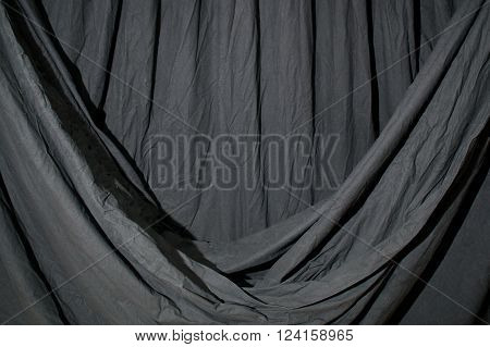 Draped Black Backdrop Cloth Lit By Blue Green Gel