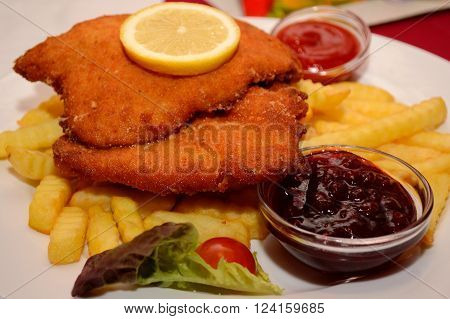 Delicious cordon bleu with fries on the plate