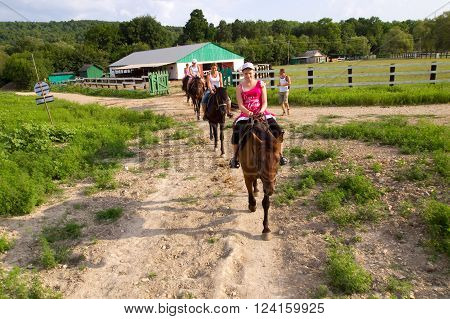 Lazarevskoe, Russia - august 04, 2012, Horseback riding on a dirt road, Lazarevskoe