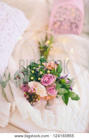 Bouquet of roses on a woolen blanket, closeup