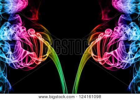 abstract rainbow smoke on black background with copy space, colorful smoke concept
