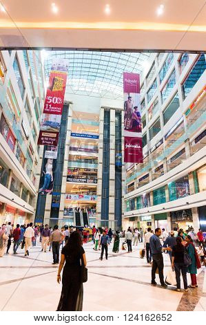 DELHI, INDIA, 22ND OCTOBER 2016 - People roaming around in a shopping mall in Delhi Gurgaon India. airconditioned malls have become a great hangout in the delhi summer heat