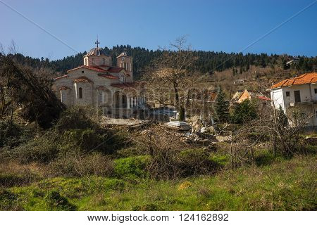 Image of sliding village Ropoto and church after a landslide in Greece