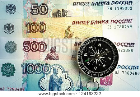 compass on the background and banknotes rubles