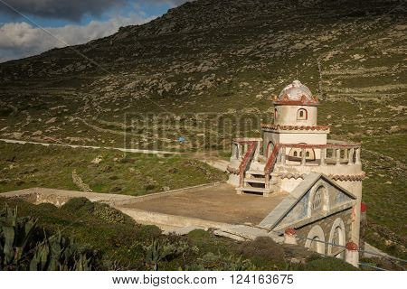 White church at the side of the road at Tinos Greece