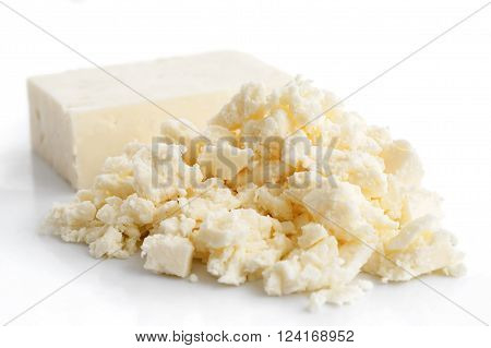 Crumbled White Feta Cheese Isolated On White.