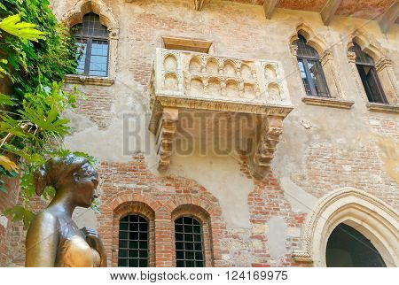 Verona, Italy - May 26, 2015: Statue and Juliet's balcony in Verona. The main tourist attraction.