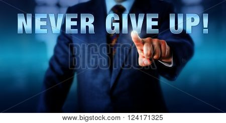 Male management coach is pushing NEVER GIVE UP! on a visual interactive screen. Business coaching concept, professional motivational metaphor and call to action. Copy space over blurred background.