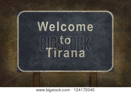 Distressed welcome to Tirana road sign illustration with ominous background