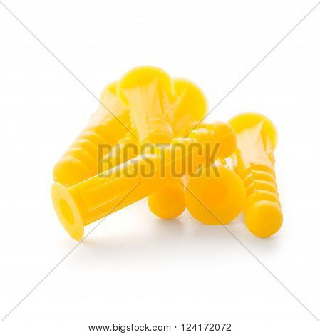 Yellow plastic dowels isolated on white background.