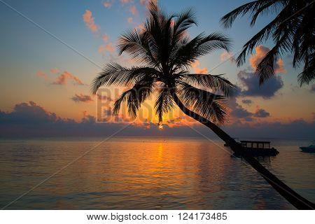 Sunset over ocean on Maldives