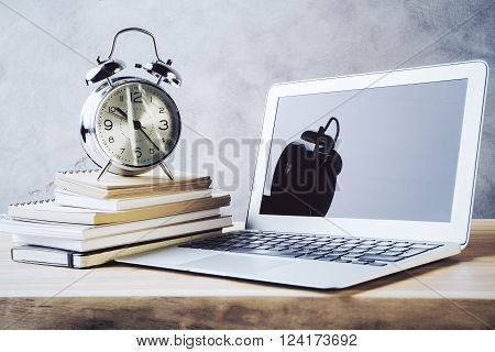 Alarm On Books And Laptop