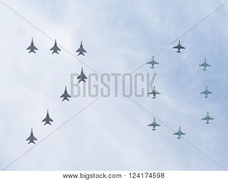 Moscow - May 9 2015: Fifteen aircraft MiG-29 and Su-25 performing aerobatics in the sky and the number 70 on the Victory Parade which stands for 70 years of the Victory over Nazi Germany May 9 2015 Moscow Russia