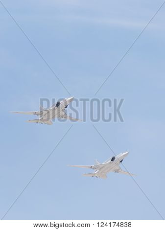 Moscow - May 9 2015: Two Tu-22M for the codification of NATO: backfire supersonic bomber-missile in flight to the Victory Parade in Moscow on May 9 2015 Moscow Russia