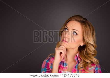 Portrait Of Attractive Minded Woman With Curly Hair Dreaming About Smth
