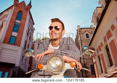 Nice Boy In Glasses Sitting On Moped