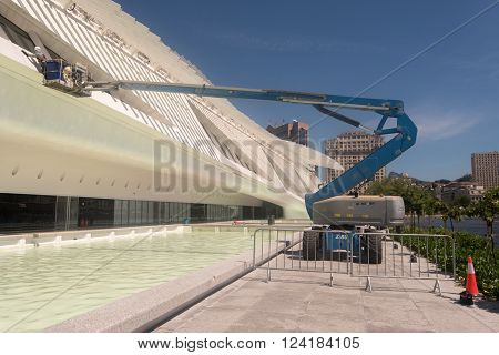 Rio de Janeiro, Brazil - March 21, 2016: Maintenance of the Museum of Tomorrow. Workers are cleaing the building.